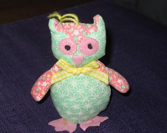 Has small floral OWL standing or hanging