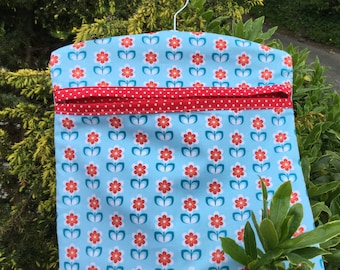Peg Bag or Clothes Pin Bag in Blue Retro Flower fabric with a Red Spot lining. Double lined for extra strength with a wooden hanger.