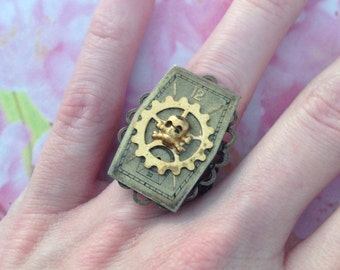 Ring adjustable COG and framing death's head clock