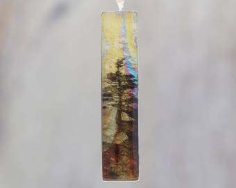 Hanging On - Glow-in-the-dark pendant with a surreal image of trees