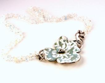 enamelled silver pendant on aquamarine cord