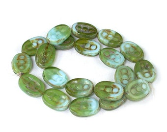 """Green transparent Pale Aqua Blue opaque w/ Brown picasso finish 18 x 12mm oval """"peas in a pod"""" pressed glass design. Set of 6, 10 or 20."""
