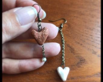 Asymmetrical earrings. Mismatched earrings. Heart earrings. Brick red and white. Dangle earrings. Heart drop earrings. Mismatched earrings.