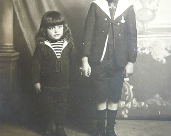 Two young brothers in sailor suit antique photography 1900 studio portrait french children sepia photo kid in nautical outfit paper ephemera