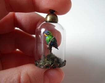 Firey throated Hummingbird - OOAK Biosphere Brass Jewelry - Clear glass cylinder with a delicate rainbow coloured hummingbird