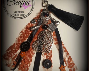 """bag charm inspired by """"buttons and lace"""" trilogy"""