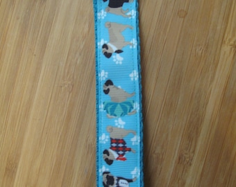 Adorable PUGS ON PARADE Pug Key Fob - Great Stocking Stuffers!  Backed on Turquoise poly-web