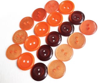 light peachy,dark orange, and burnt orange eco friendly buttons--three shades and styles--mixed lot of 19