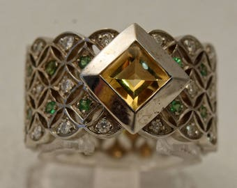Ring in yellow gold and yellow Topaz diamond subilites Green