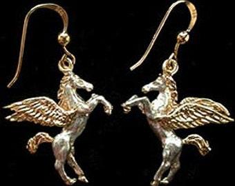 Pegasus boucles d'oreilles en or 18 carats sur de l'argent.