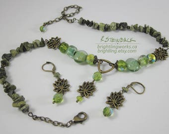 Tranquility Necklace/Earrings Set; Stylized Bronze Lotus Blossoms Accented with Green Iridescent & Transparent Lined Glass and Natural Stone