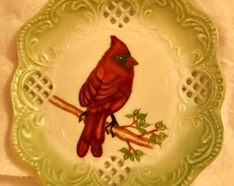 Red cardinal hand painted on a decorative plate