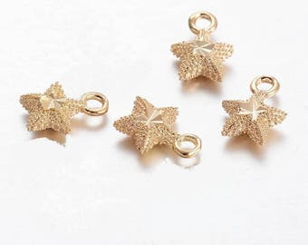 x 4 star 8 mm gold plated pendant.