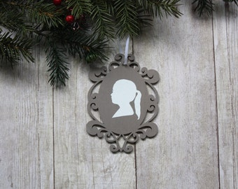 Custom silhouette tan and white laser-cut wood frame ornament