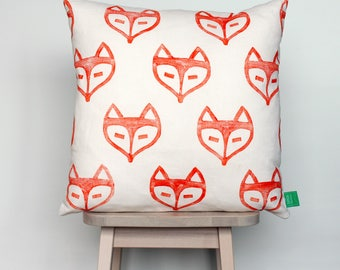 Cushion cover with orange foxes, hand-stamped