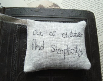 Out of clutter find simplicity - Albert Einstein Lavender sachet in linen with embroidered text