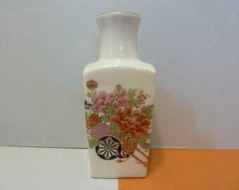 Small Vase, Oriental Design, of Flowers in 2 Wheel Cart