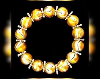 Comfortable marbled yellow elastic bracelet
