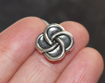 12 for flat leather or cord - silver metal flower beads