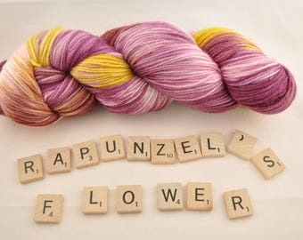 "Hand-dyed yarn, ""Rapunzel's Flower"" variegated, soft and squishy yarn. Great for socks or shawls. 80/20/ Superwash wool/Nylon"