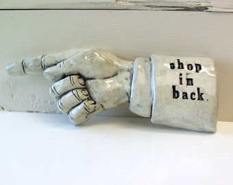 Shop In Back. Ceramic Pointing Finger With Concealed Hooks.