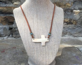 Carved Whelk Shell Cross necklace