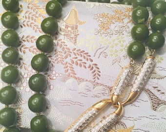 Vintage 1960's green glass beaded necklace with stunning pave rhinestone clasp.
