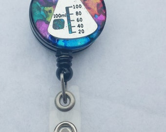 Science beaker name badge holder with a multicolor background