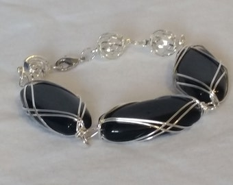 Silver wrapped black stones