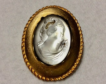Glass bejewelled repousse cameo brooch pin.