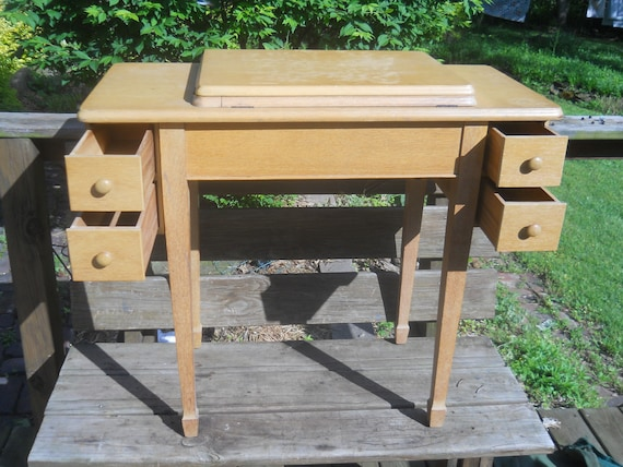 Vintage Singer Blonde Sewing Machine Table/Cabinet  With 4 Drawers, Dust  Bottom And Knee Bar A Singer 66 Came Out Of This Table
