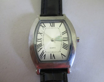 Vintage Lady's watch with black patent leather band used no markings