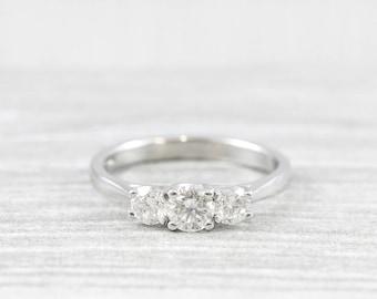 Three stone diamond engagement ring trilogy in platinum