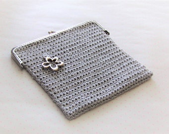 Small silver coloured clutch
