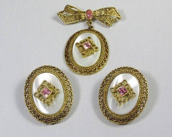 Mother of pearl brooch and matching earrings set.