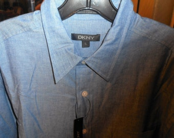 Nice Shirt    by DKNY    Size Large     Never Worn,   Still With Tags On it