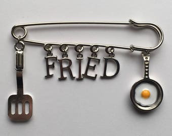 FRIED Egg in Pan and Spatula Kilt Safety Pin - Charms: Spatula or Flipper, Shiny Silver Letters, Egg in Pan - FREE U.S. Shipping!