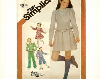 """A Miniskirt, Knickers, Pants, and Long Sleeve Top Sewing Pattern for Girls: Size Large (12-14), Breast 30"""" - 32"""" • Simplicity 5771"""