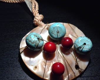 Mother of Pearl pendant worked with turquoise and coral