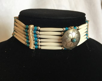 Thin hair pipe buffalo bone choker with turquoise blue white heart glass beafs and silver center focal