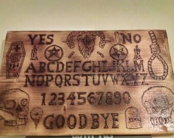 Ouija board hangs on wall hand made