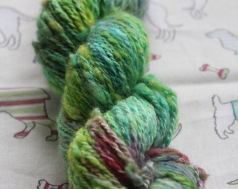 Hand spun, hand dyed, Blue Faced Leicester wool, Aran/worsted weight. Bumpy texture.