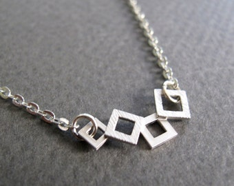 Tiny Geometric Necklace, Modern Square Necklace, Silver Pendant Four Squares - CUBED