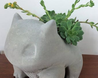 Giant concrete Bulbasaur planter