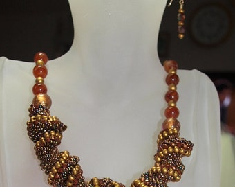 Beaded Spiral Necklace in Gold and Rust
