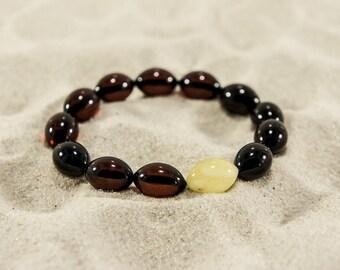 Amber bracelet, cherry and ivory elliptical natural amber bead bracelet 4949