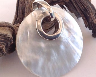 Silpada Mother of Pearl MOP Disc Round Sterling Silver Pendant on brown leather cord.