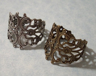 2 Adjustable Filigree Rings - Oxidized silver and Oxidized brass