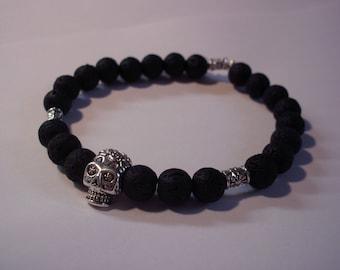 Man, lava stone and skull bracelet