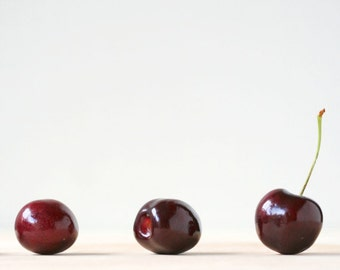 "Food photography, kitchen art, fruit photograph, red cherry, minimalist -- ""Offbeat"", a 5x5-inch fine art photo"